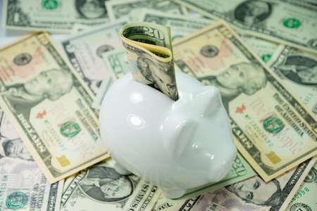 A piggy bank and cash