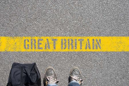 Foto de A man with a suitcase is on the border with Great Britain - Imagen libre de derechos