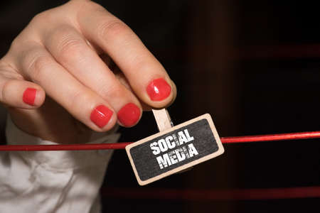 A woman and sign social media