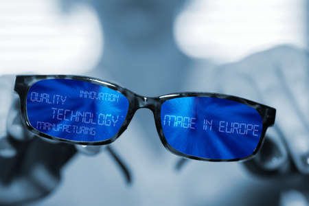 A woman and glasses with words Technology, Innovation, Manufacture and Quality Made in Europe