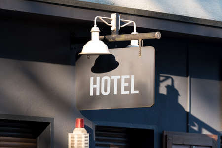 A sign indicating a hotel