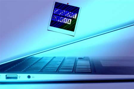 A computer and a photo social media