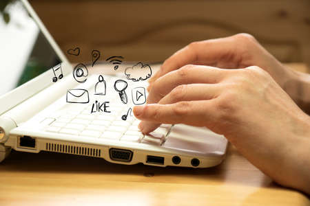 A woman at the computer and various icons for social media and other services on the Internet