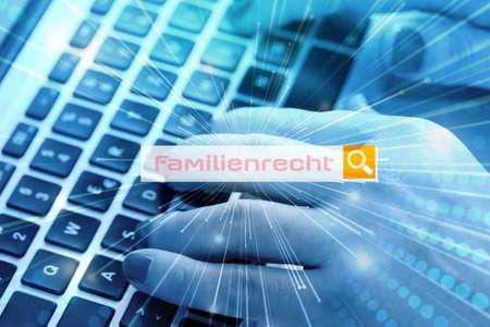 Photo pour A woman searches the Internet for the term family law - image libre de droit