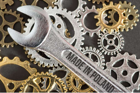 Photo pour Spanner, gears and shield Made in Poland - image libre de droit