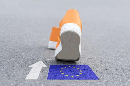 Photo pour Shoes are heading towards the European Union - image libre de droit
