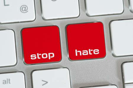 Photo pour A computer and buttons for stop hate - image libre de droit