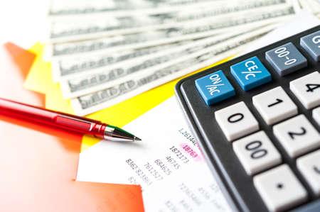 Foto de Business and financial background with dollars, data, pen and calculator. Bookkeeping background. - Imagen libre de derechos