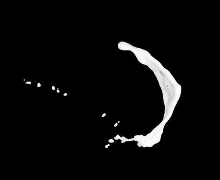 milk or white liquid splash isolated on black background.