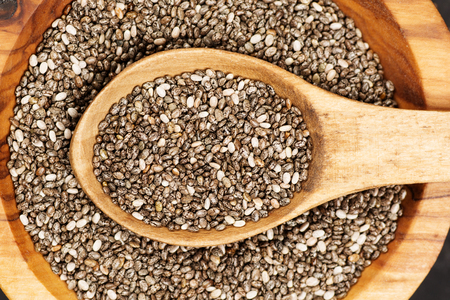 Photo for Chia seeds in organic dish on dark concrete background. Top view. Healthy food concept. - Royalty Free Image