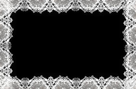 Photo pour White lace pattern isolated on  a delicate border against black background.  - image libre de droit