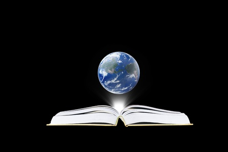 Book in the dark room with light and earth  - education concept