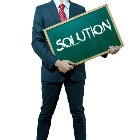 Business man holding board on the background with business word, Solution