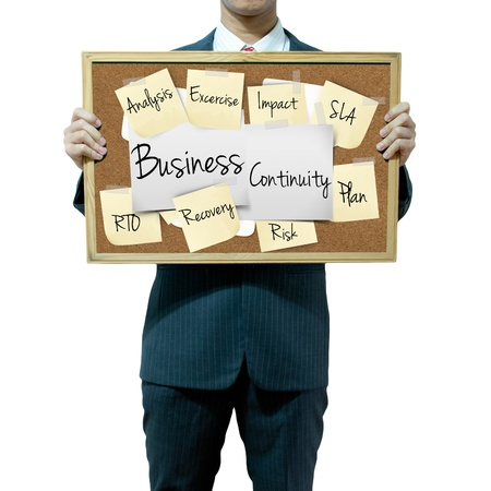 Business man holding board on the background, Business continuity