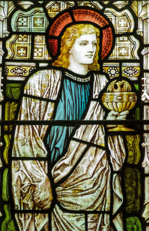 Victorian stained glass window showing the Apostle St  John the Evangelist holding a chalice containing a winged serpent  Historic window on public display over 100 years