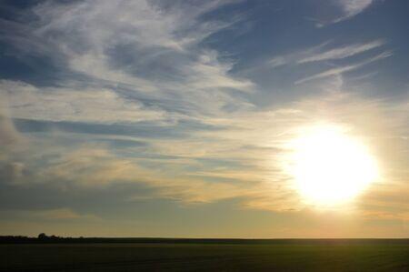 Sunset over the green plain