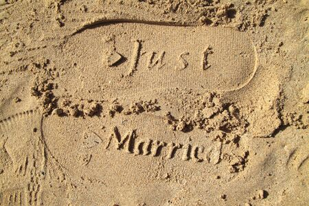 Just married imprint in the sand