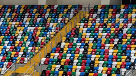 Empty stadium with seats of different colors