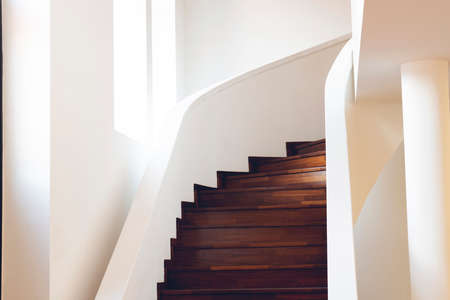 Foto per Spiral staircase inside building, Modern spiral staircase, Luxurious interior staircase, Home stair symbol, Modern stairs, Communicating element house - Immagine Royalty Free