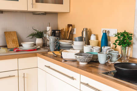 Pile of dirty dishes in the kitchen - Compulsive Hoarding Syndrome