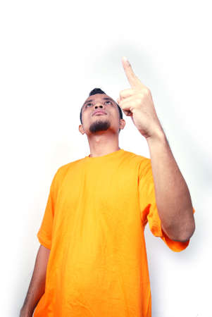 Adult man making a point by raising finger.