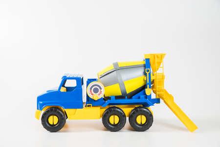 Photo pour Plastic car. Toy model isolated on a white background. Yellow-blue concrete truck. - image libre de droit