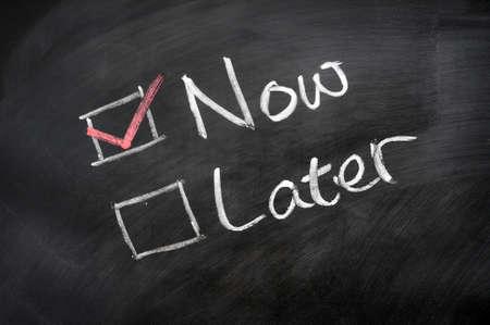 Photo pour Now and Later check boxes written on a blackboard - image libre de droit