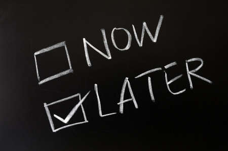 Photo pour Now and later check boxes with later chosen on a blackboard - image libre de droit