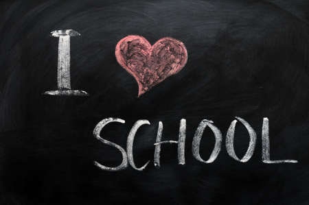 I love school - text written with chalk on a blackboard