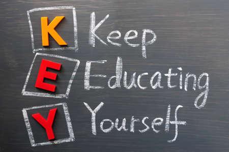 Acronym of KEY on a blackboard- Keep Educating Yourself