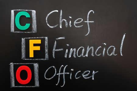 Acronym of CFO - Chief Financial Officer written in chalk on a blackboard