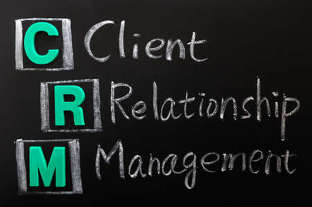 Acronym of CRM - Client Relationship Management written on a blackboard