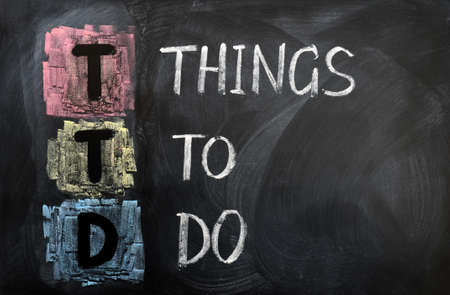 Acronym of TTD for Things to Do written in chalk on a blackboard