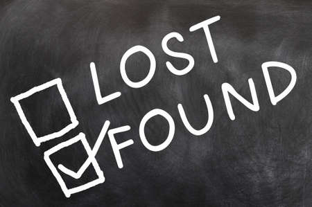 Lost and found check boxes with found checked, written with chalk on a blackboard