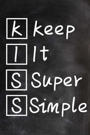 Acronym of kiss for Keep it super simple written on a blackboard