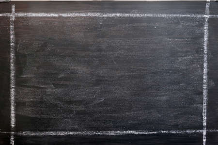 Smudged chalkboard background with a chalk drawing frame