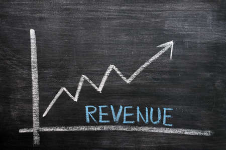Chart of revenue growth drawn with chalk on a chalkboard