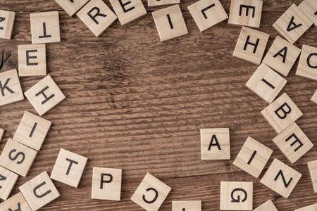 Foto de cube letters on a wooden table as a background - Imagen libre de derechos