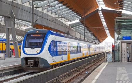 Amsterdam, Netherlands - June 23, 2014: White-blue shuttle train stays on Amsterdam Arena rail station