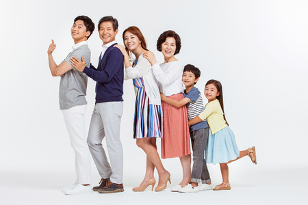 Foto de Portrait of Happy Asian Family - Imagen libre de derechos
