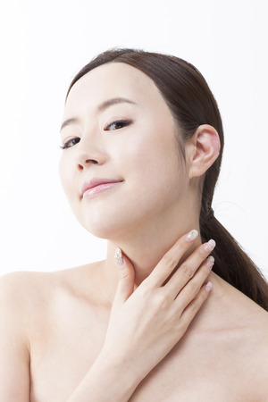 Portrait of Asian beautiful woman hand touch her neck isolated on white