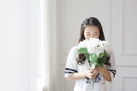 Asian woman holding bouquet