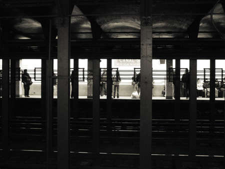 Silhouette of Passengers Waiting in New York City Subway Station
