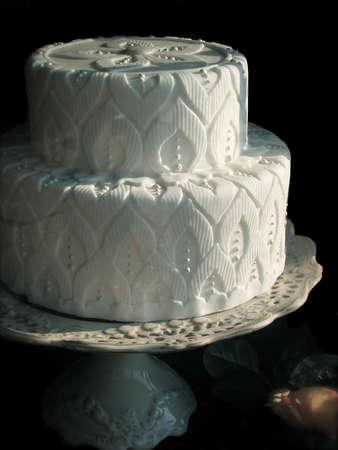 Elaborate White Wedding Cake on Cake Stand Isolated Over Black Background