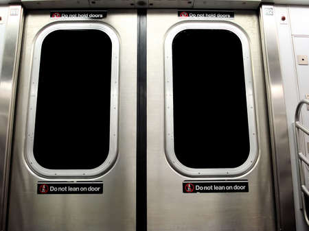 New York City Subway Train with Do Not Lean on Door Warning Sign