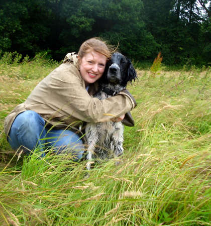 Woman Posed with Munsterlander Breed Hunting Dog in Field