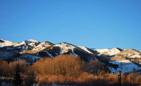 Snowy Ski Slopes on Mountains in Park City, Utah, in the Early Morning Light