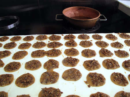 Traditional Southern pecan praline candies made in copper pot