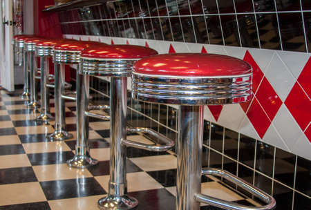 Classic 50s style bar stools in chrome and red