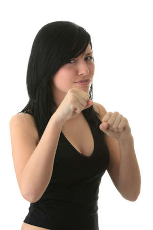 Young atractive girl with scary mine trying to make boxing